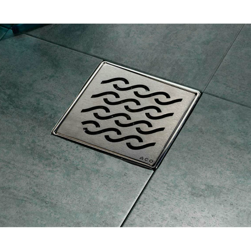 ACO Q- Plus Point Drain installed with wavy stainless steel grate