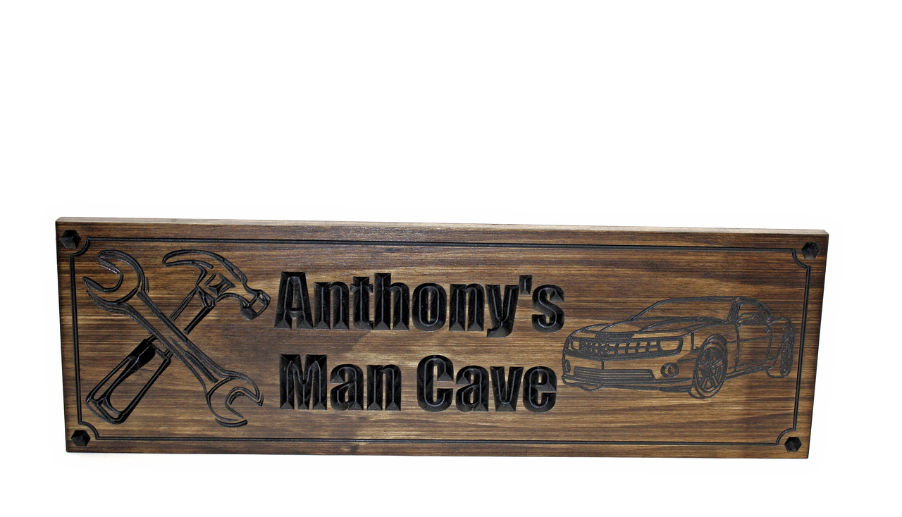 garage man cave sign with wrenches and camaro