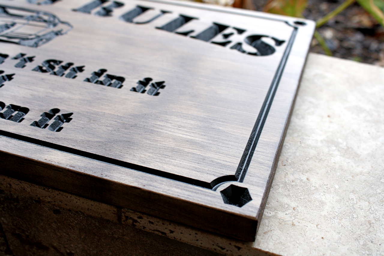 man cave sign with  nuts and bolts