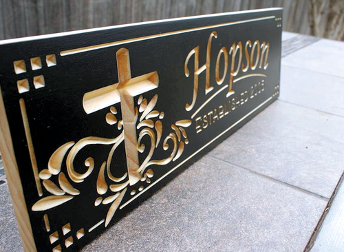 custom wood sign with family name and cross