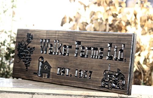 Wine farm sign with tractor and barn