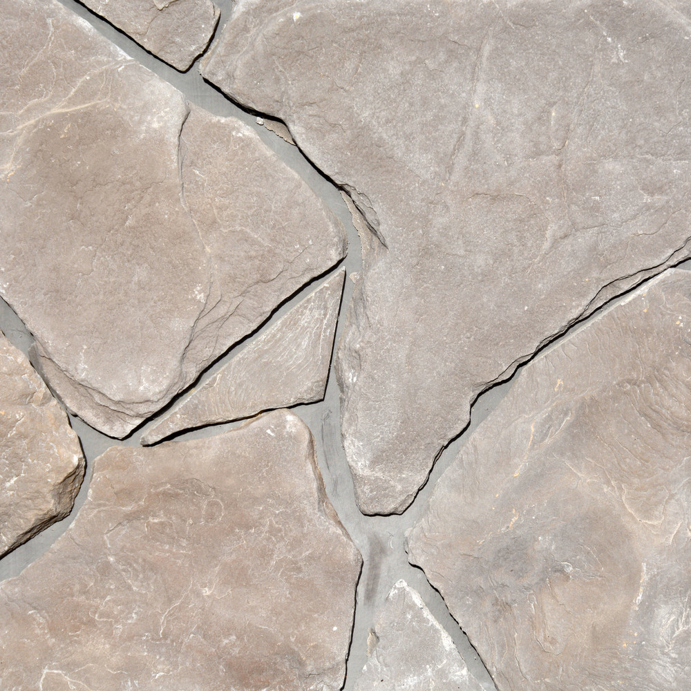 Photo of Summit Colorway Fieldstone Stone Veneer samples from Superior Stone MFG with a darker grey grout