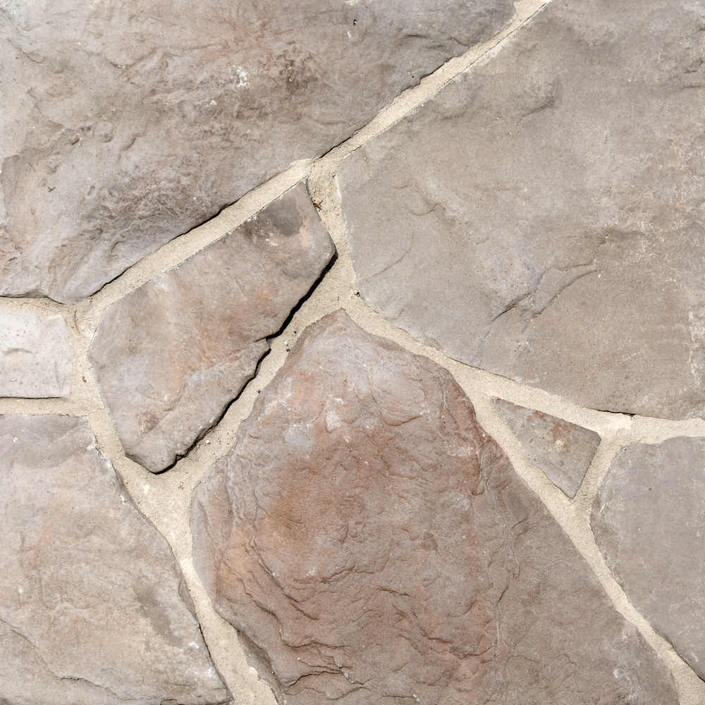 Photo of Summit Colorway Fieldstone Stone Veneer samples from Superior Stone MFG with a lighter tan grout.