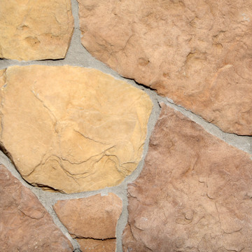 Photograph of Washington based Superior Stone MFG's Fieldstone stone siding in the Cascade colorway. Shown with a lighter grey grout.