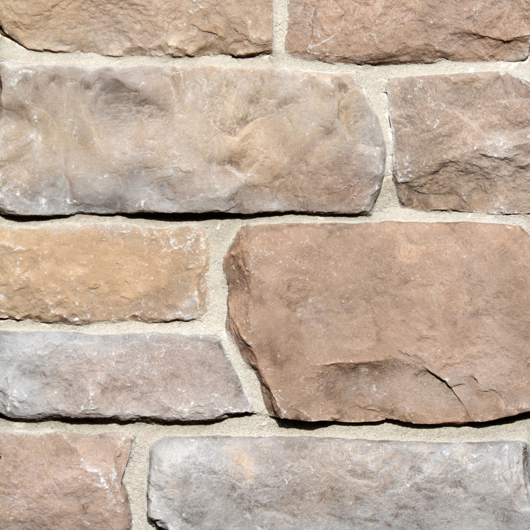 Picture of a Limestone Stone Veneer in the Summit color palette by Superior Stone (Washington based).  Shown here with light grout.