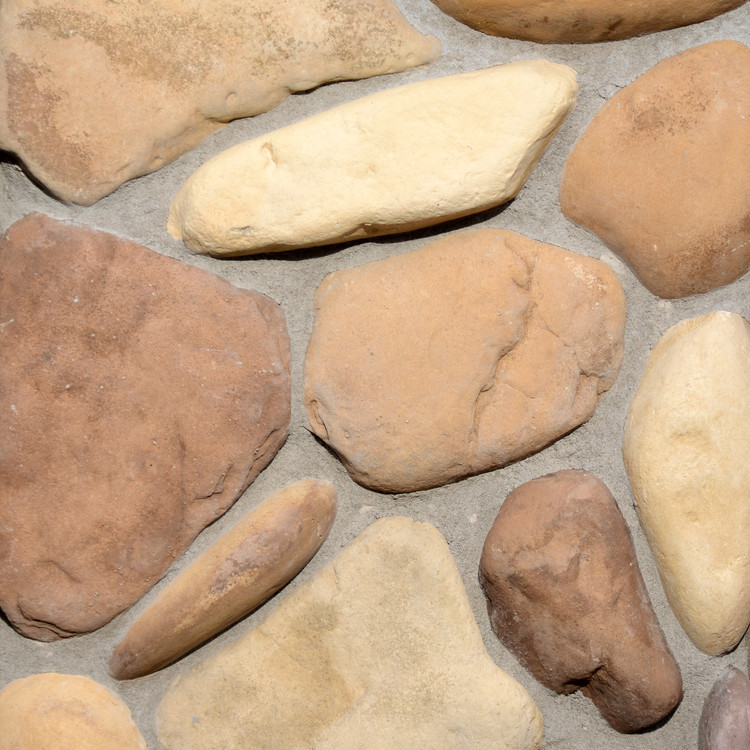 Picture of a River Rock stone siding in the Cascade color palette by Superior Stone (Washington based).  Shown here with light mortar bed.
