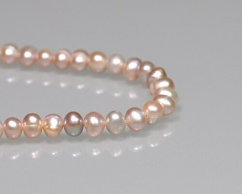 """Near Round Peach Freshwater Pearls 5-6mm 