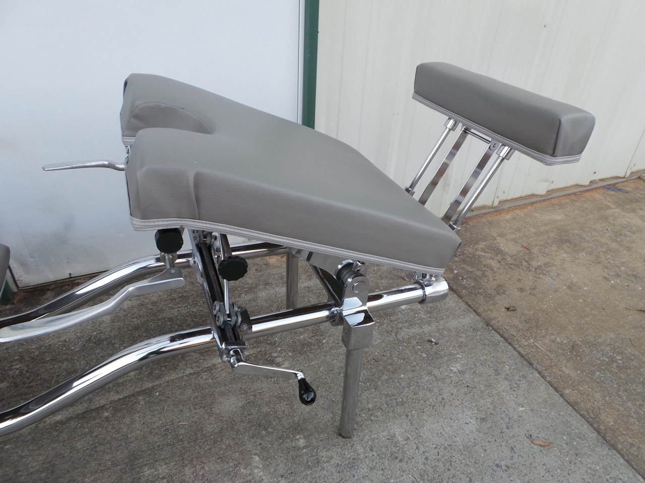 Used Zenith 55F Stationary Table with  Pelvic and Ankle Elevated. Pelvic Drop can be used when pelvic cushion is Elevated.