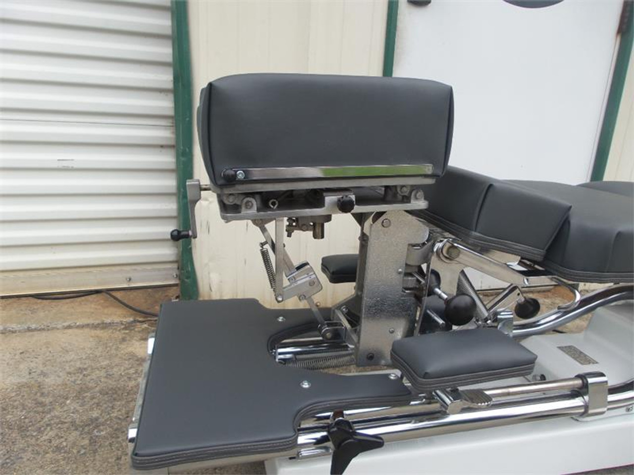 Used Zenith II 220F Hylo Table with Elevating Three Notch Cervical , shown  in Top Position.