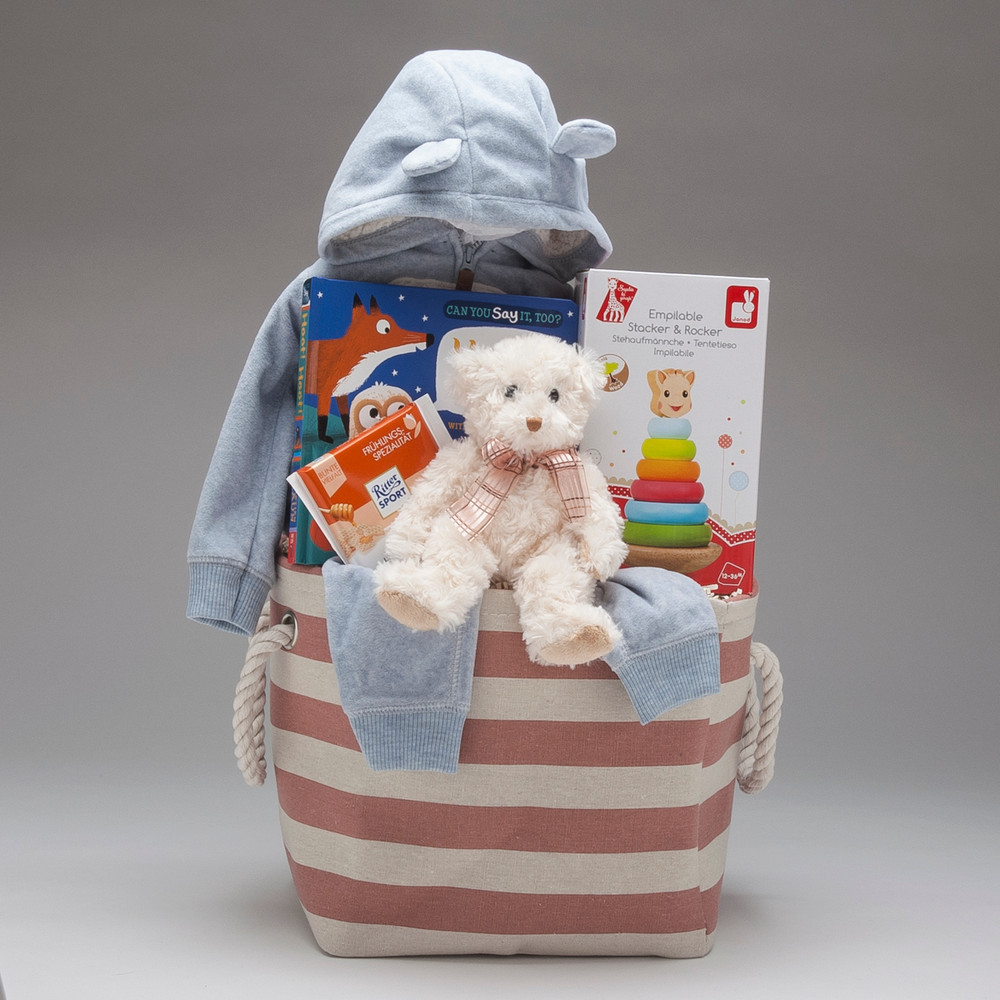 A gift that will keep on giving well into the Toddler Years, featuring a classic wooden stacking toy & an old-fashioned Fuzzy Teddy Bear by Douglas, and so much more, all held in a soft cloth sack perfect for tossing toys into! Also available for Baby Girl.