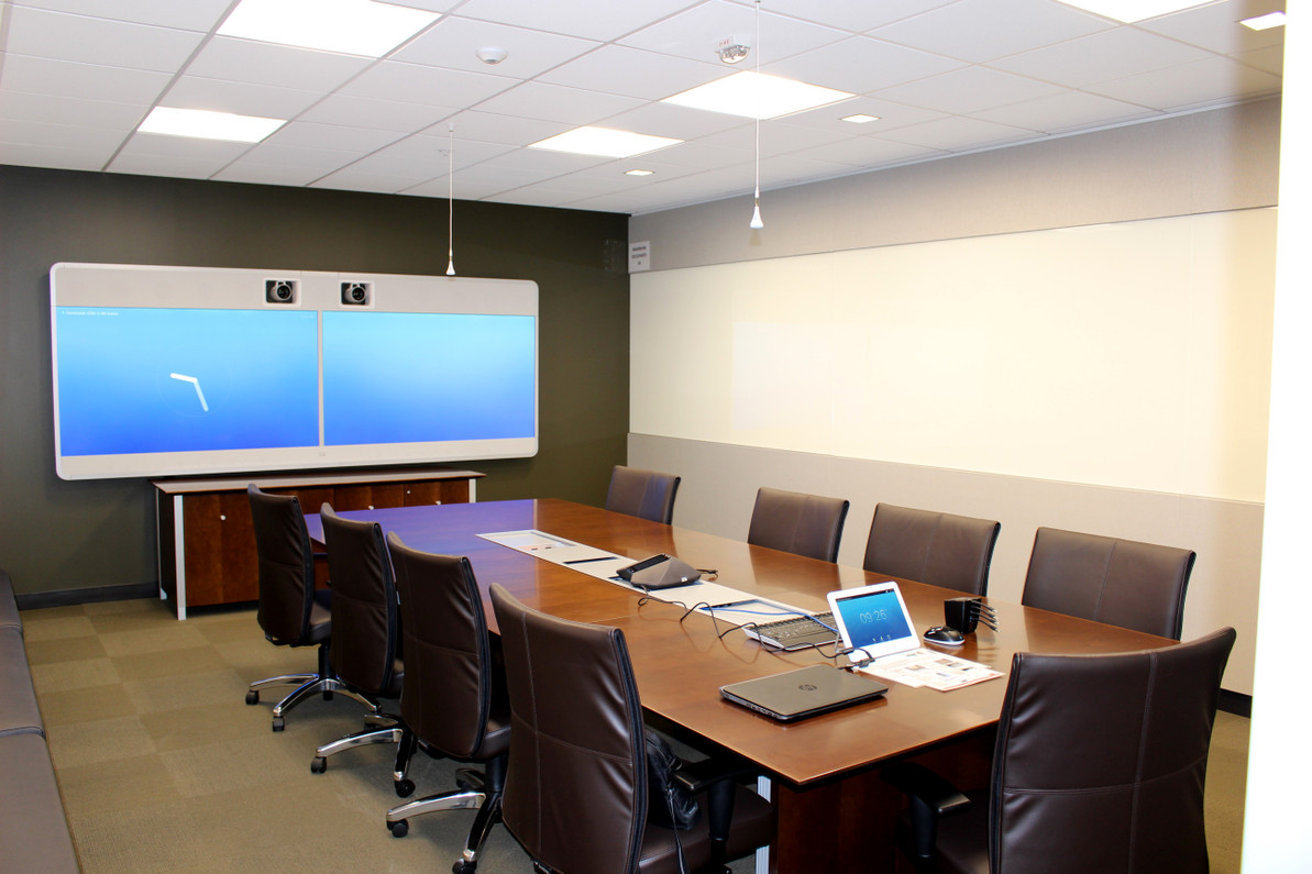 Board room with cisco, clickshare, and ceiling mics