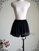 Inside black skirt