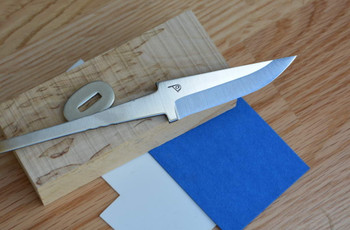Showing the Polar blade with Silver Birch handle block, a nickel silver bolster and some spacer materials.