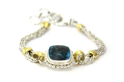 Gold/Silver Bracelet with Blue Topaz Stone