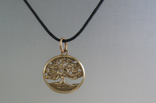 Tree Pendant Spreading Oak in bronze 25mm wide shown with natural finish on a black cotton cord