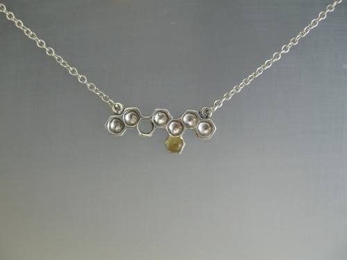 Honey comb bar pendant and sterling chain with 8 cells and one is set with a citrine