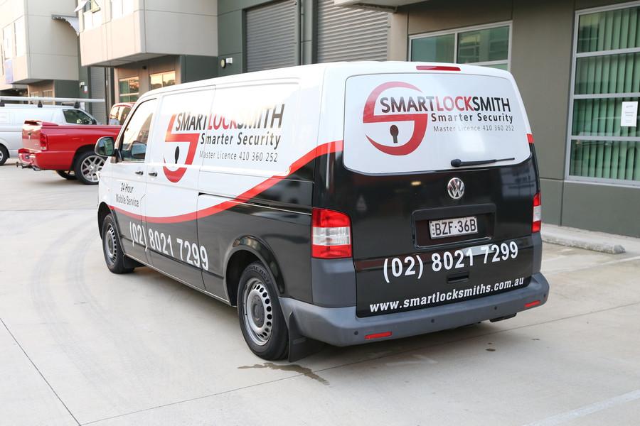 Smart Locksmith Van with Reflective Numbers