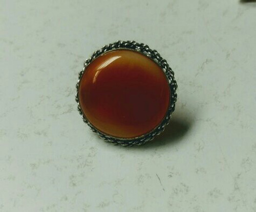 Big Carnelian. Adjustable band. made with Tibetan brass. Size is approximate.