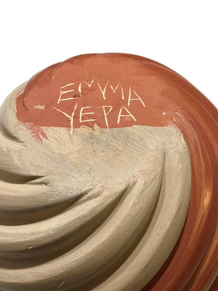 Traditional Jemez Potter, Emma Yepa, creates beautiful contemporary style pottery using traditional elements.