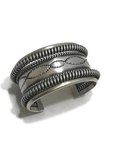 "Native American made sterling silver cuff bracelet with a stamp of ""Tahe""."