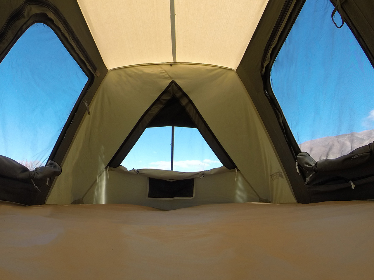 Wide angle view from inside with windows zipped open.