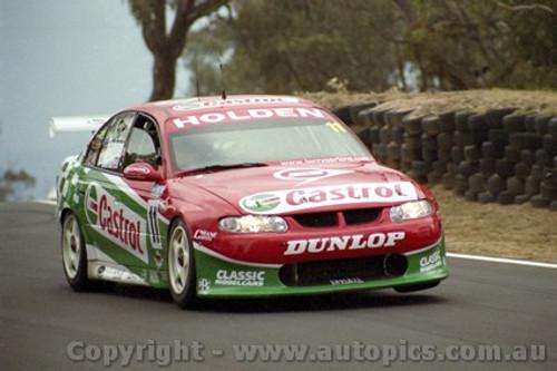 202724 - L. Perkins & P. Dumbrell  Holden Commodore VX - Bathurst 2002 - Photographer Craig Clifford