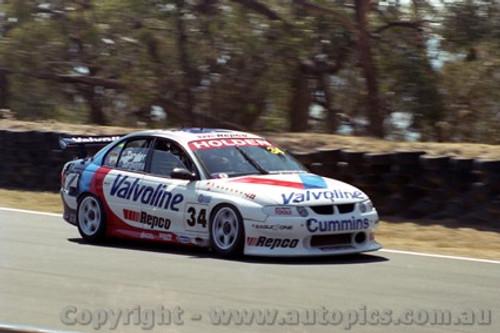 202730 - G. Tander & J. Bargwanna  Holden Commodore VX - Bathurst 2002 - Photographer Craig Clifford