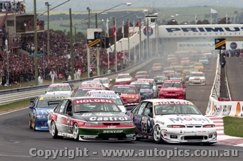 97700 - The Start of the Supercheap Auto 1000  Bathurst 1997 - Brock  and Perkins lead the pack. - Photographer Marshall Cass