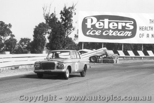 64016 - F. Sutherland / A. Mottram Studebaker Lark  - in the background the  Lex Davison  Ford Galaxie - Sandown 6 Hour International  29th November 1964
