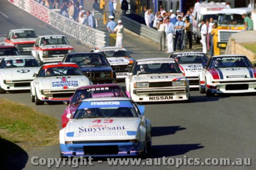 82015 - Moffat leads the start - G. Burgess #33 Mazda RX7 - Amaroo Park 1982