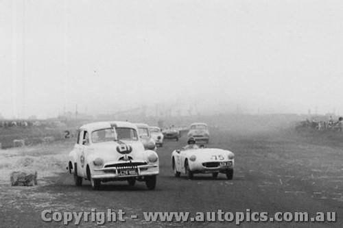 59009 - #81 - D. Ashton - FJ Holden - #75 - H. Firth - Austin Healey Sprite - Fishermen s Bend - 10th October 1959 - Photographer Peter D Abbs