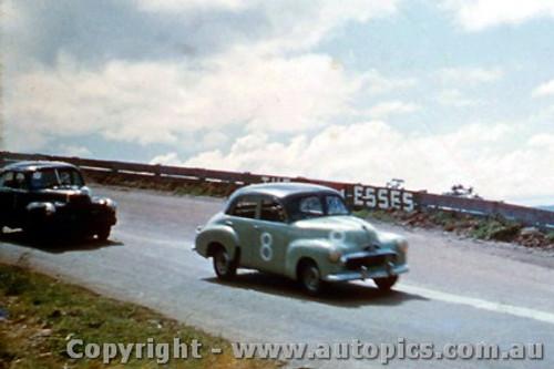 59011 - J. French FJ Holden and Leo Geoghegan FX Holden  - Bathurst 1959 - Photographer  Harry Cape   Slightly out of focus