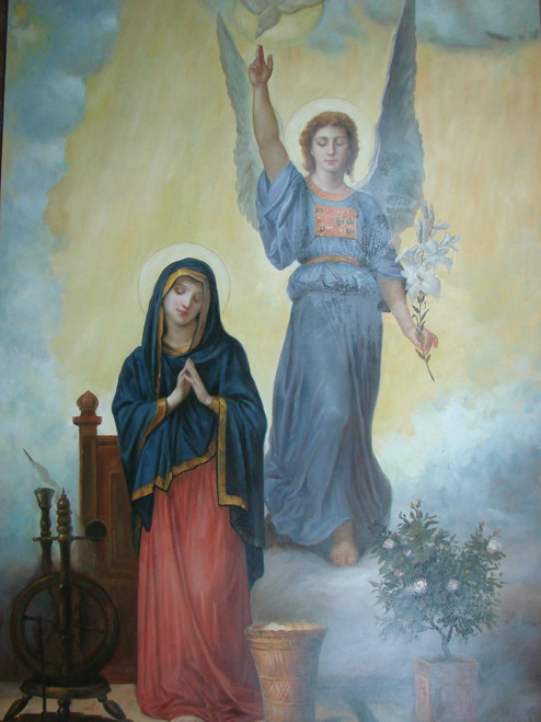Very large religious painting, stretched canvas but without frame, by Belmont.  An angel dressed in light blue robes watches over a religious woman dressed in red and blue.
