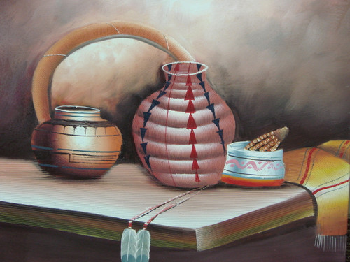 Beautiful medium sized painting, stretched but without frame, by J. Prama.  A table holds a collection of Native American artifacts including a light orange blanket, painted clay pots, and feathers with beads.