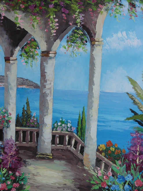 Beautiful, vertical painting, stretched but without frame, by Damini.  A white balcony with columns covered in green ivy, and purple and blue flowers, overlooks blue water.