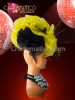 CHARISMATICO asymmetrical organza ruffled headdress in yellow and black with feather accents