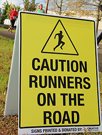 Caution Runners on the Road