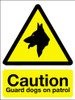 Caution guard dogs on patrol sign
