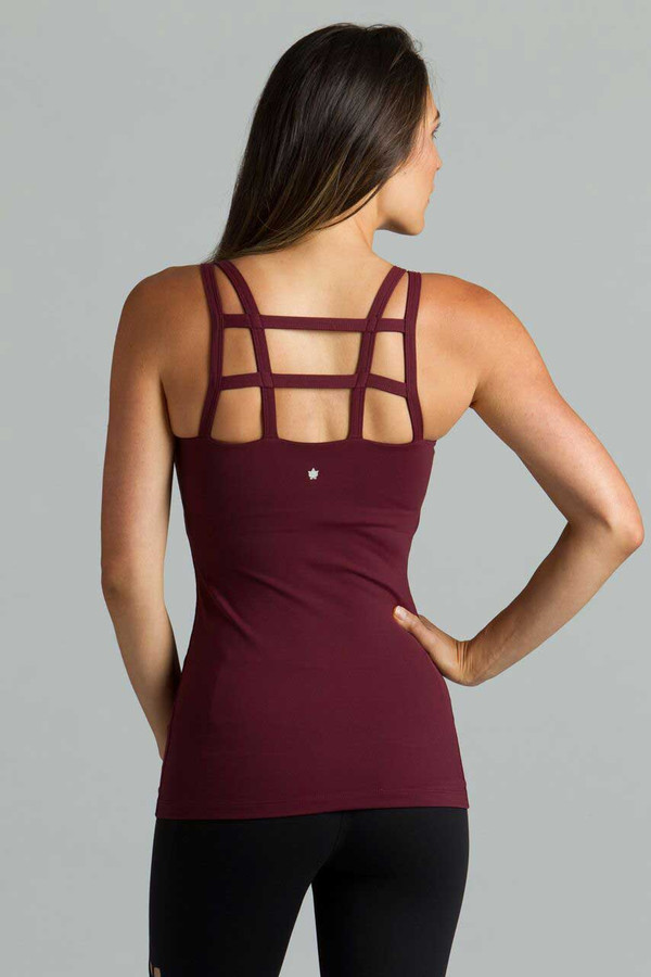 Model wearing KiraGrace supportive Caged Tank in bordeaux with back caging detail