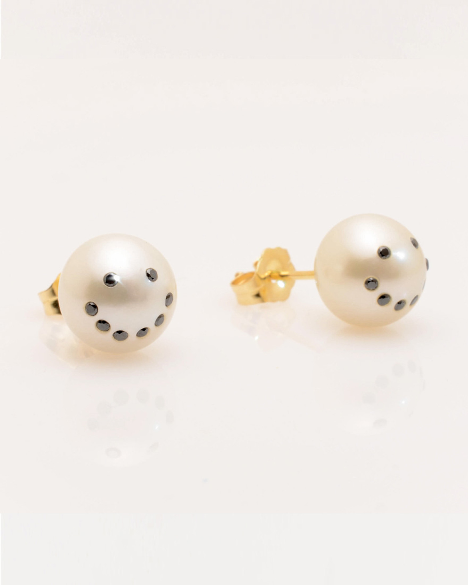 3/4 view of Cultured Freshwater Pearl Earrings with Smiley Emoji Diamond Pavè & 14k Gold Posts (8-9 mm) by Jewelry Designer Nektar De Stagni
