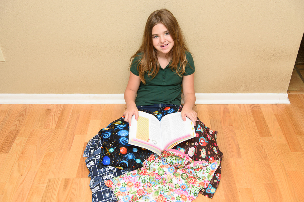 Why Your Child Should Have a  Weighted Lap Pad or Weighed Vest in the Classroom this Fall