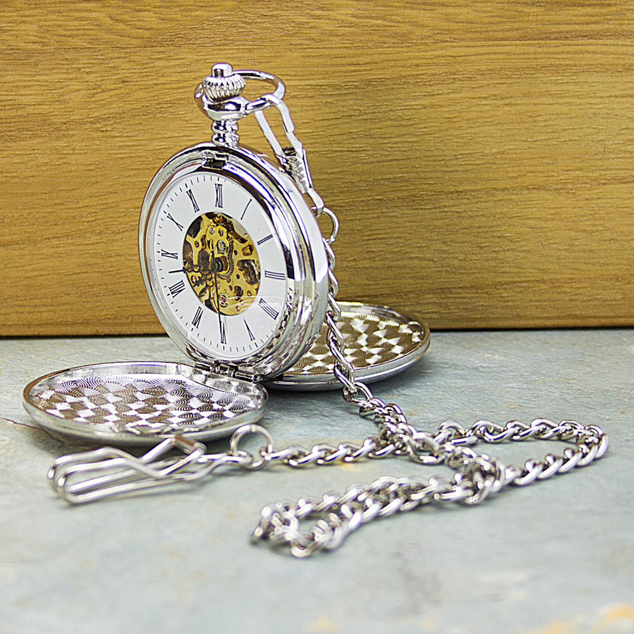 caf61ef0e7c45 Stylish engraved mechanical pocket watch with golden cut out displaying the  mechanism working inside