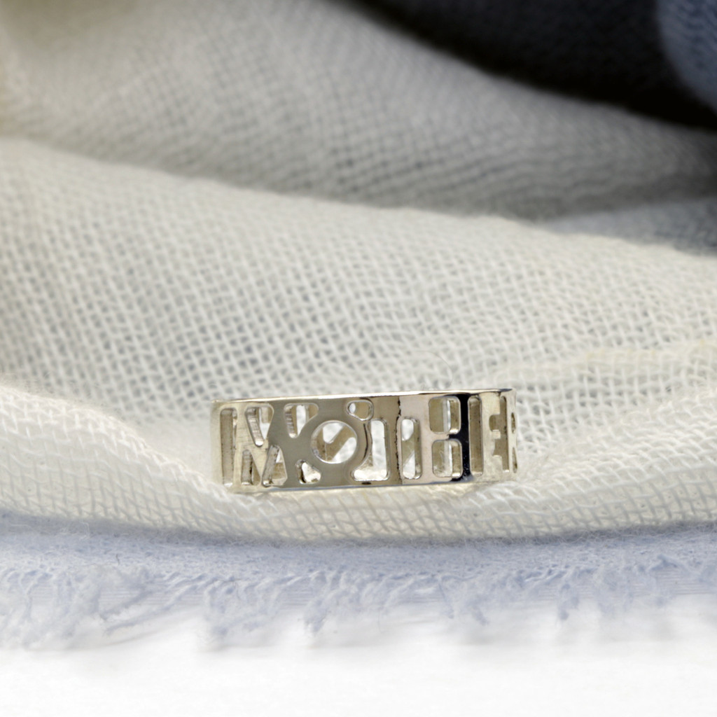 Sterling silver handcrafted Mother Runner ring.