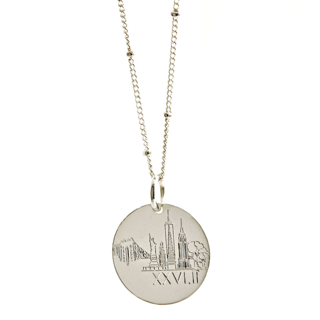 New York City Skyline Marathon Necklace. Show in sterling silver on satellite chain.