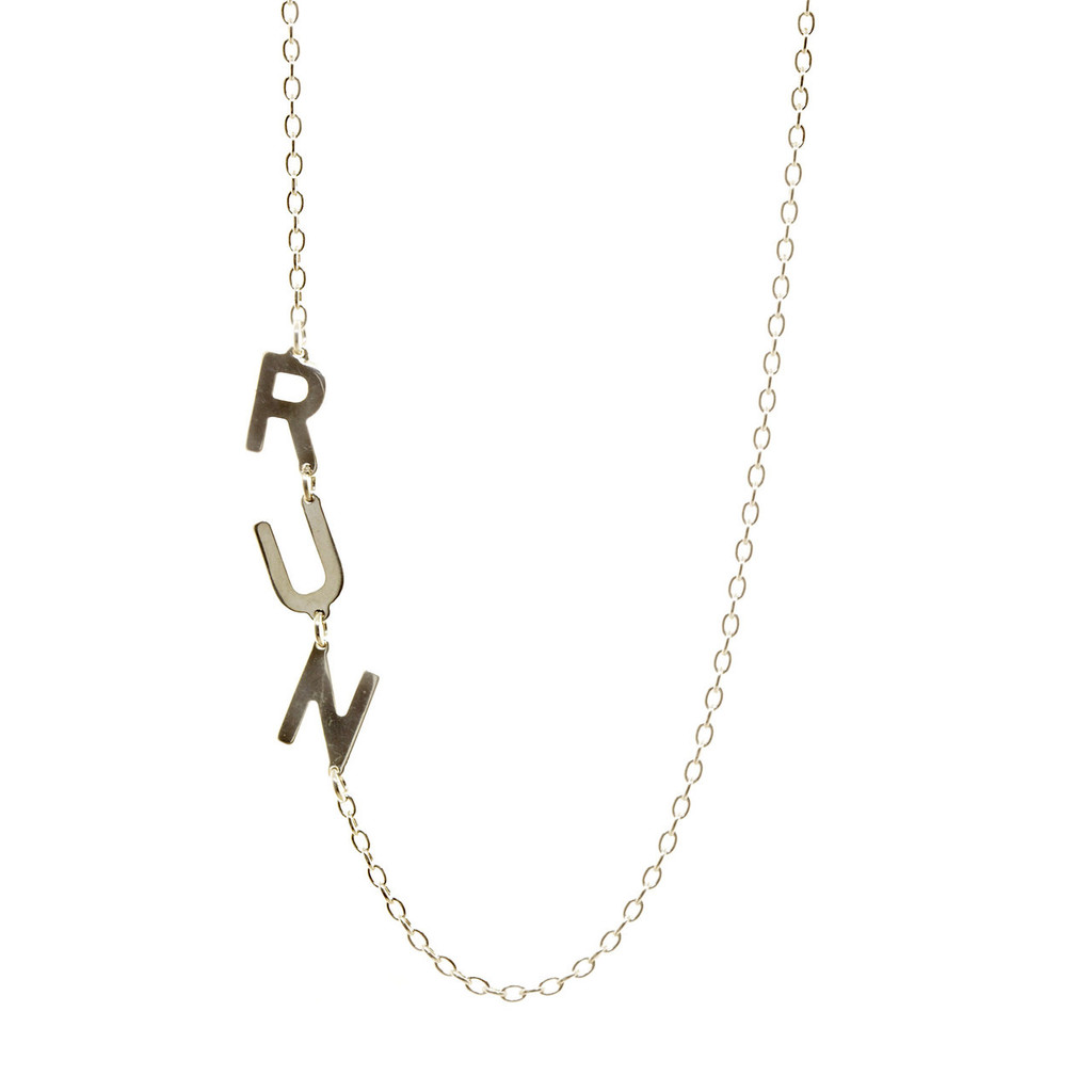 Sterling silver handcrafted asymmetrical initial necklace.