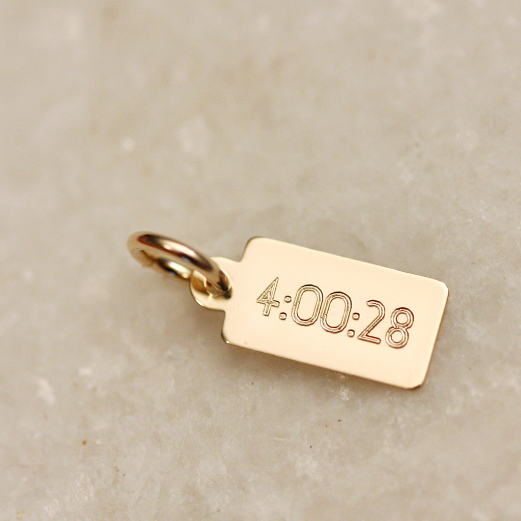 finishing time engraved on back of charm