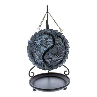 Yin and Yang are represented on the front of this backflow incense burner with two sides of dragons with two distinct textures.