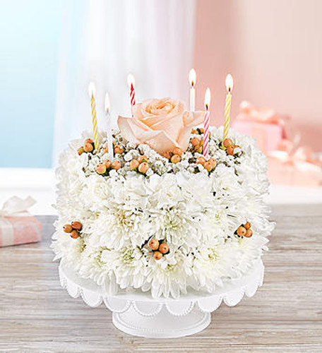 Birthday Wishes Flower Cake™ Sweetness DESIGN COUNCIL EXCLUSIVE Start with a truly original idea, throw in dash of flowery fun and you've got one sweet birthday celebration! Our new flower cake is a fresh delight, hand-arranged with soft white blooms and a delicate rose on top. Created by Breanna Cartwright from Fresh Ideas Flower Company in Modesto, California shop, it's a one-of-a-kind design, perfect for displaying on such a special day.