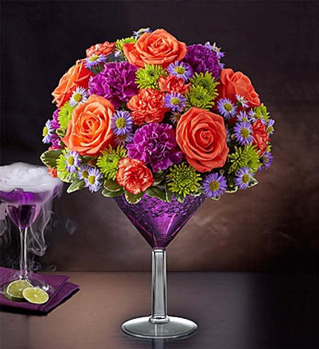 Shocktail Martini Bouquet™ EXCLUSIVE We're shaking things up for Halloween with our shocking cocktail creation! It's the perfect mix of vibrant orange and purple blooms inside an oversized martini glass, for a colorful, one-of-a-kind centerpiece sure to make any Halloween or seasonal celebration straight-up fun.