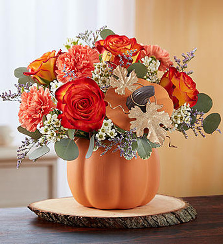 Pumpkin Petals™ EXCLUSIVE Send joyful autumn smiles with a gift that's simply gourd-geous! Our stunning display of seasonal orange and white blooms arrives inside our artful ceramic pumpkin container complete with lid and glittering gold, metallic leaf accents. It's a festive gift that can later be used to hold holiday treats, or simply to add a delightful touch of fall décor.